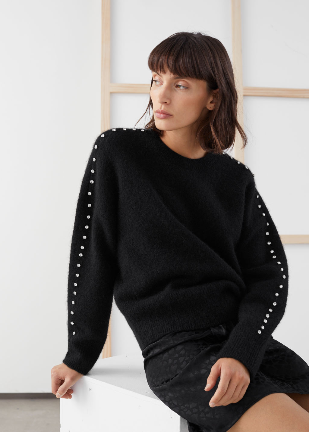 Model front image of Stories rhinestone embellished sweater in black