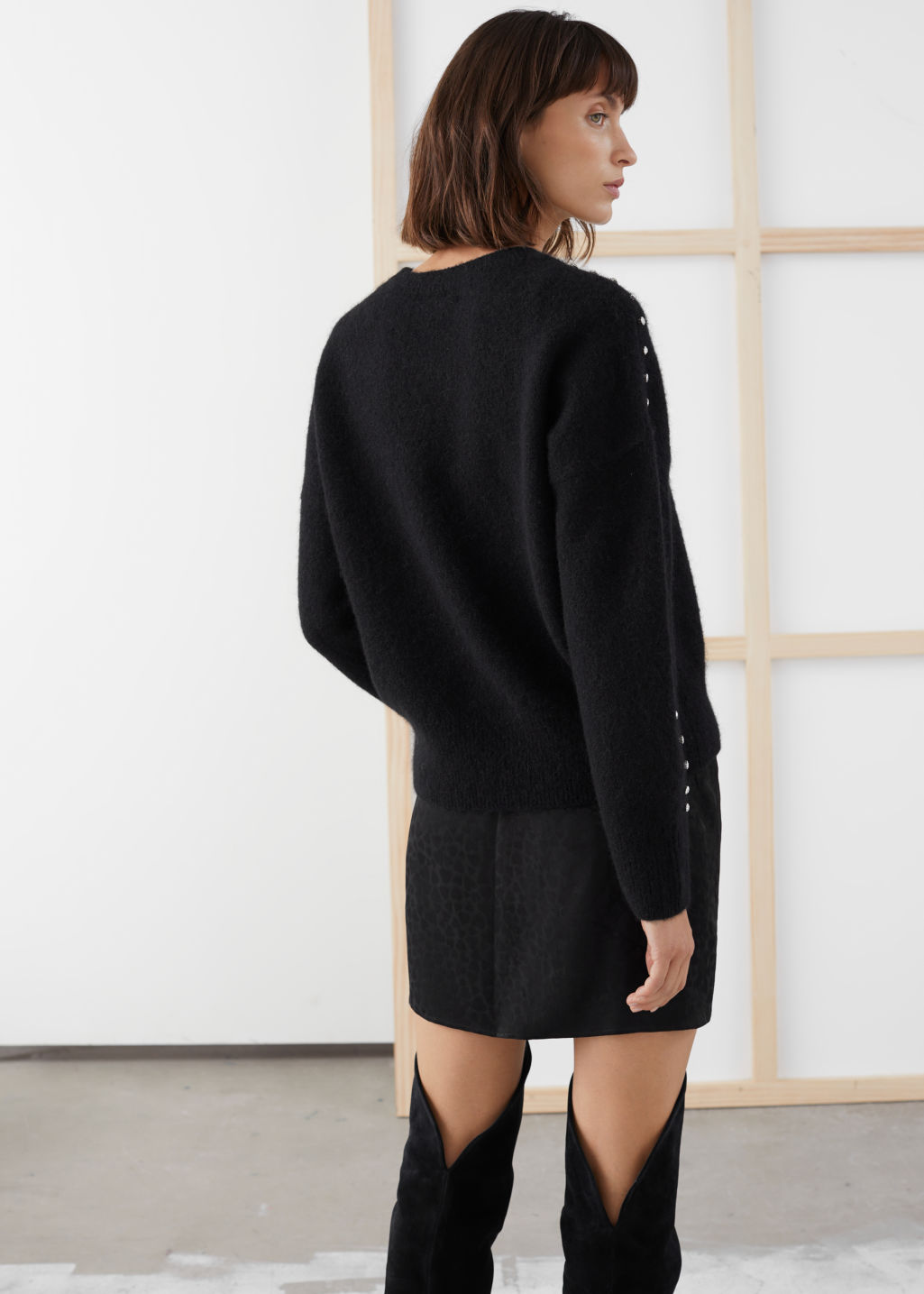 Model back image of Stories rhinestone embellished sweater in black