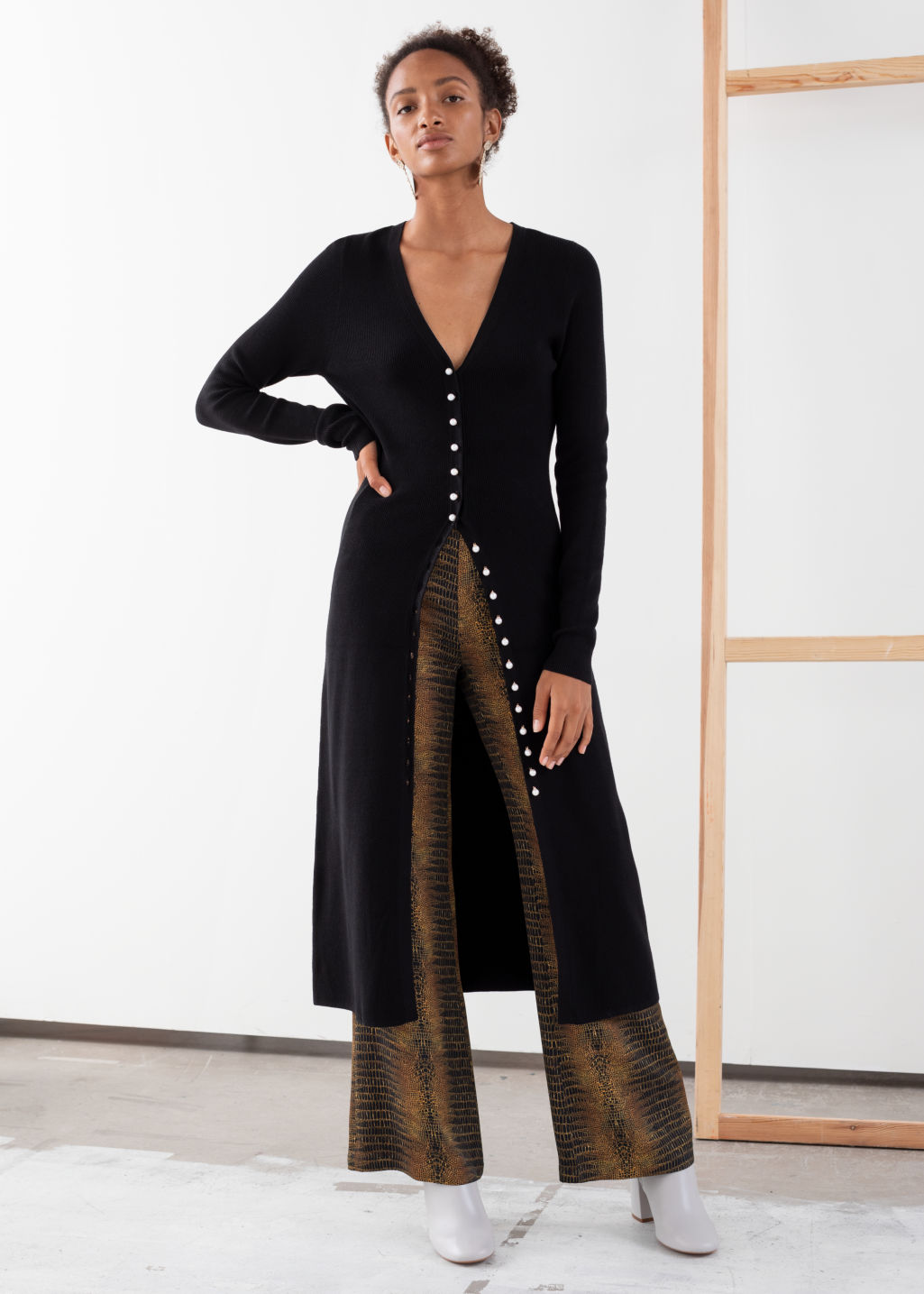 Model front image of Stories ribbed knit button up midi dress in black