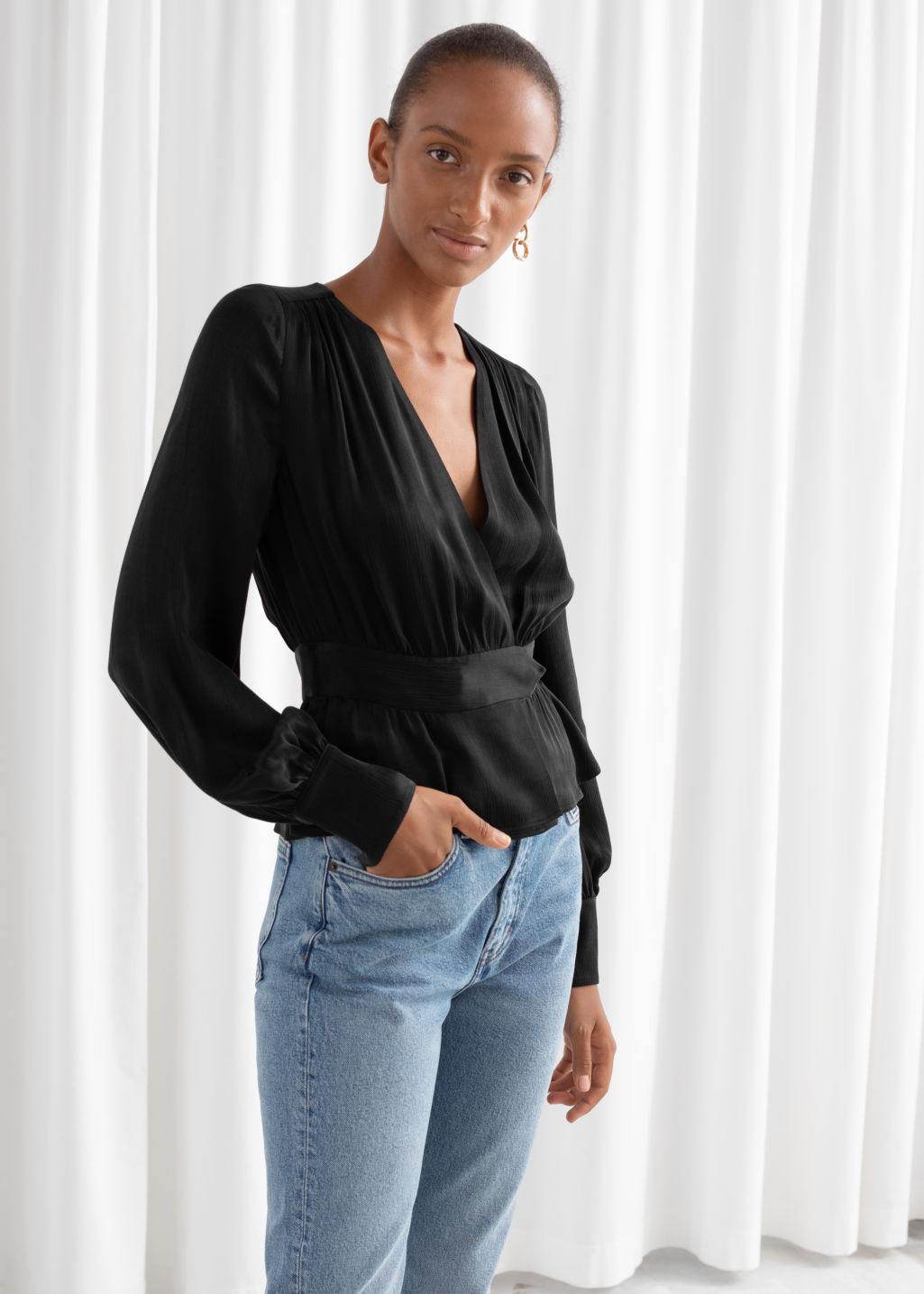 Model front image of Stories belted satin wrap blouse in black