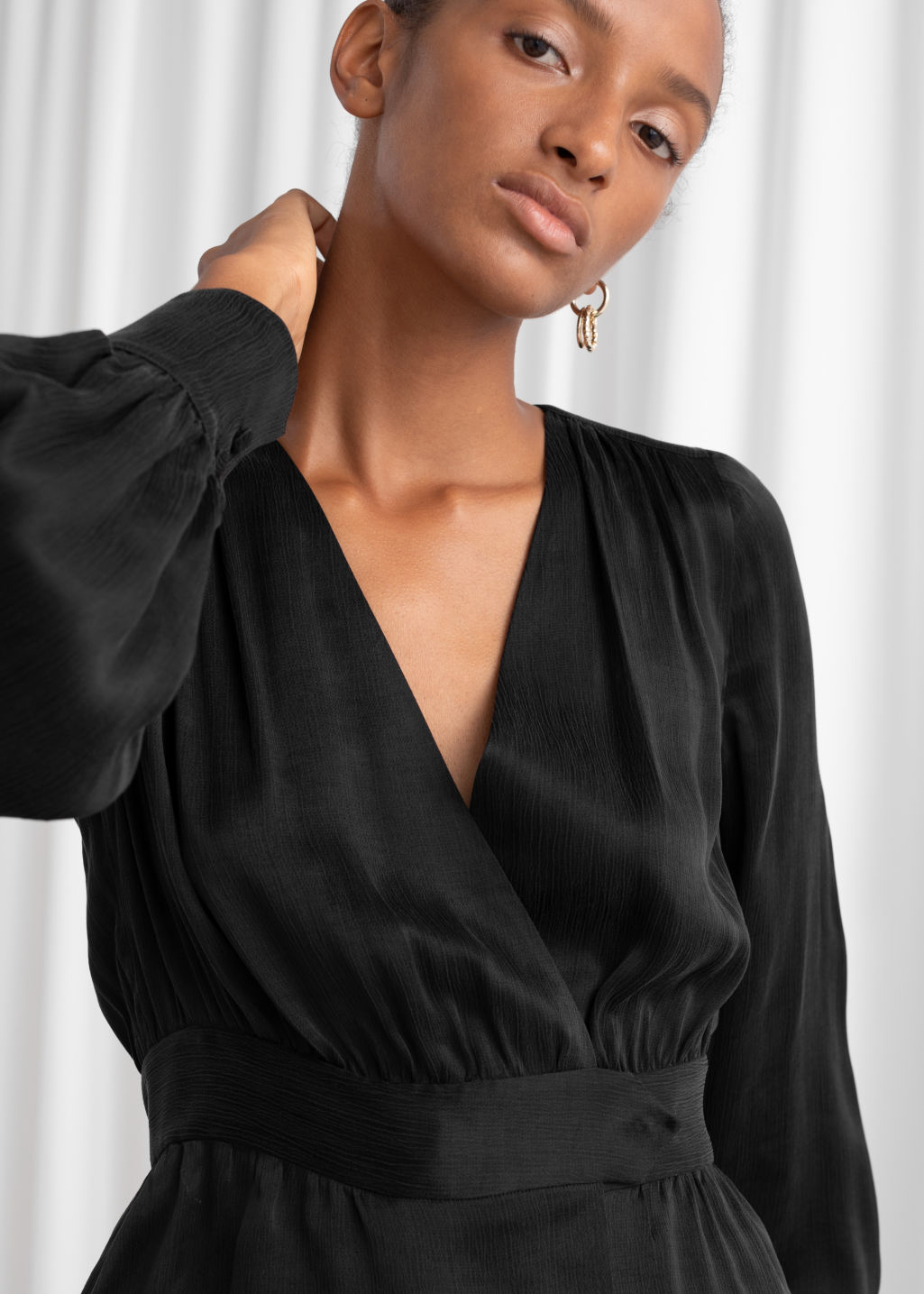 Model back image of Stories belted satin wrap blouse in black