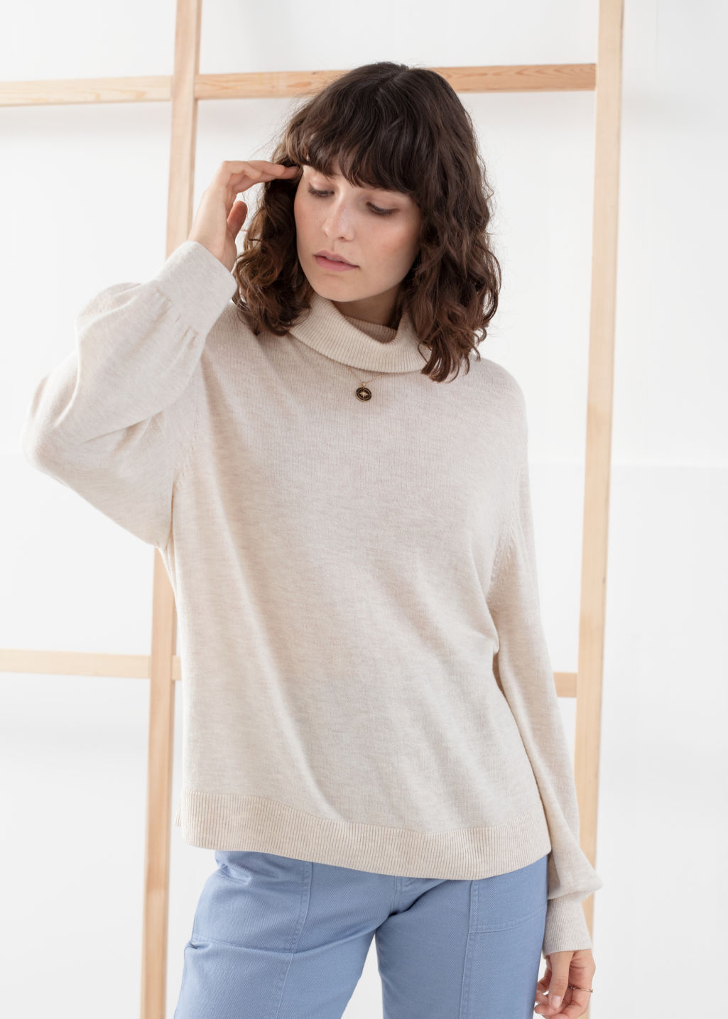 Model front image of Stories soft wool blend turtleneck sweater in white