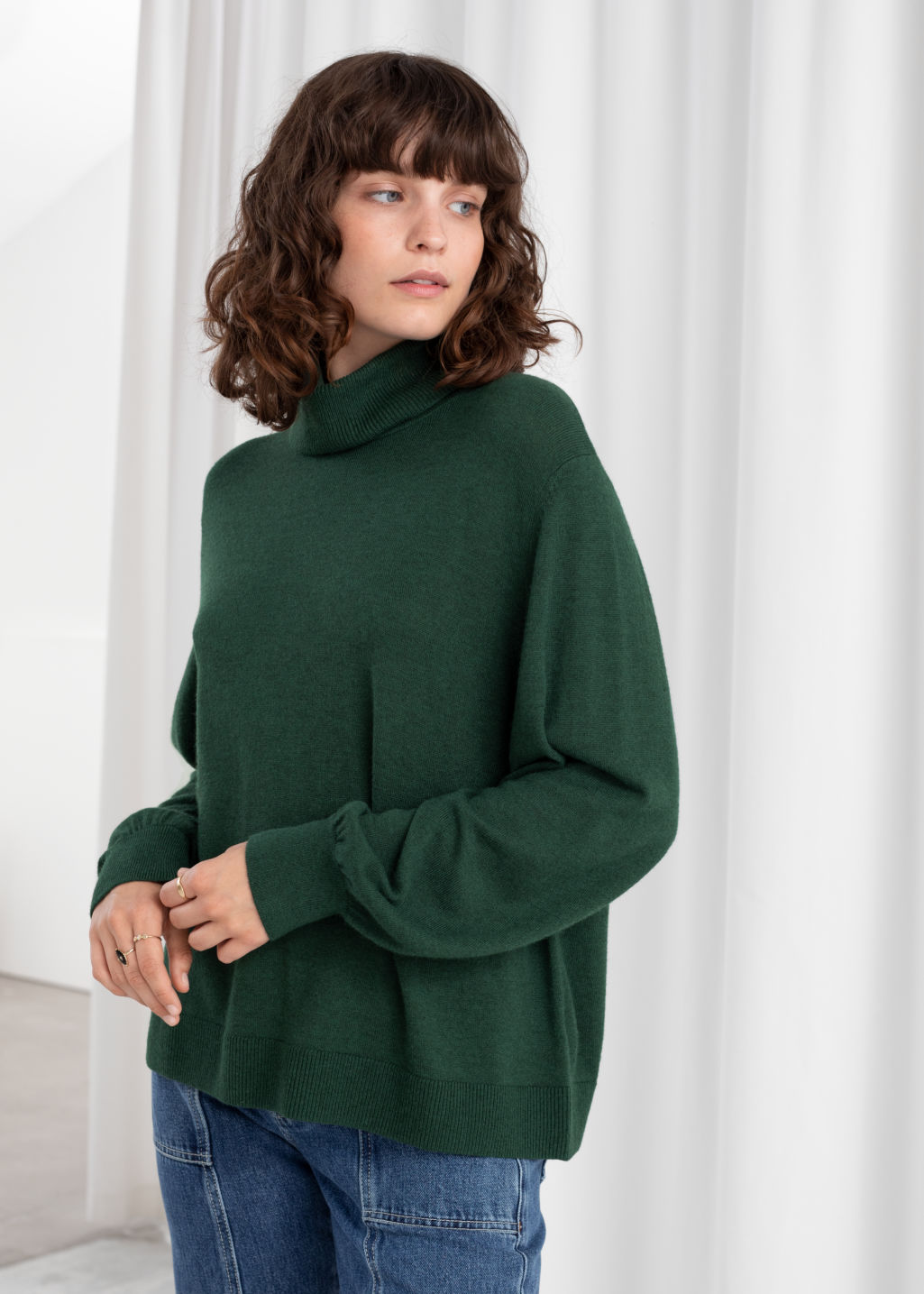 Model front image of Stories soft wool blend turtleneck sweater in green