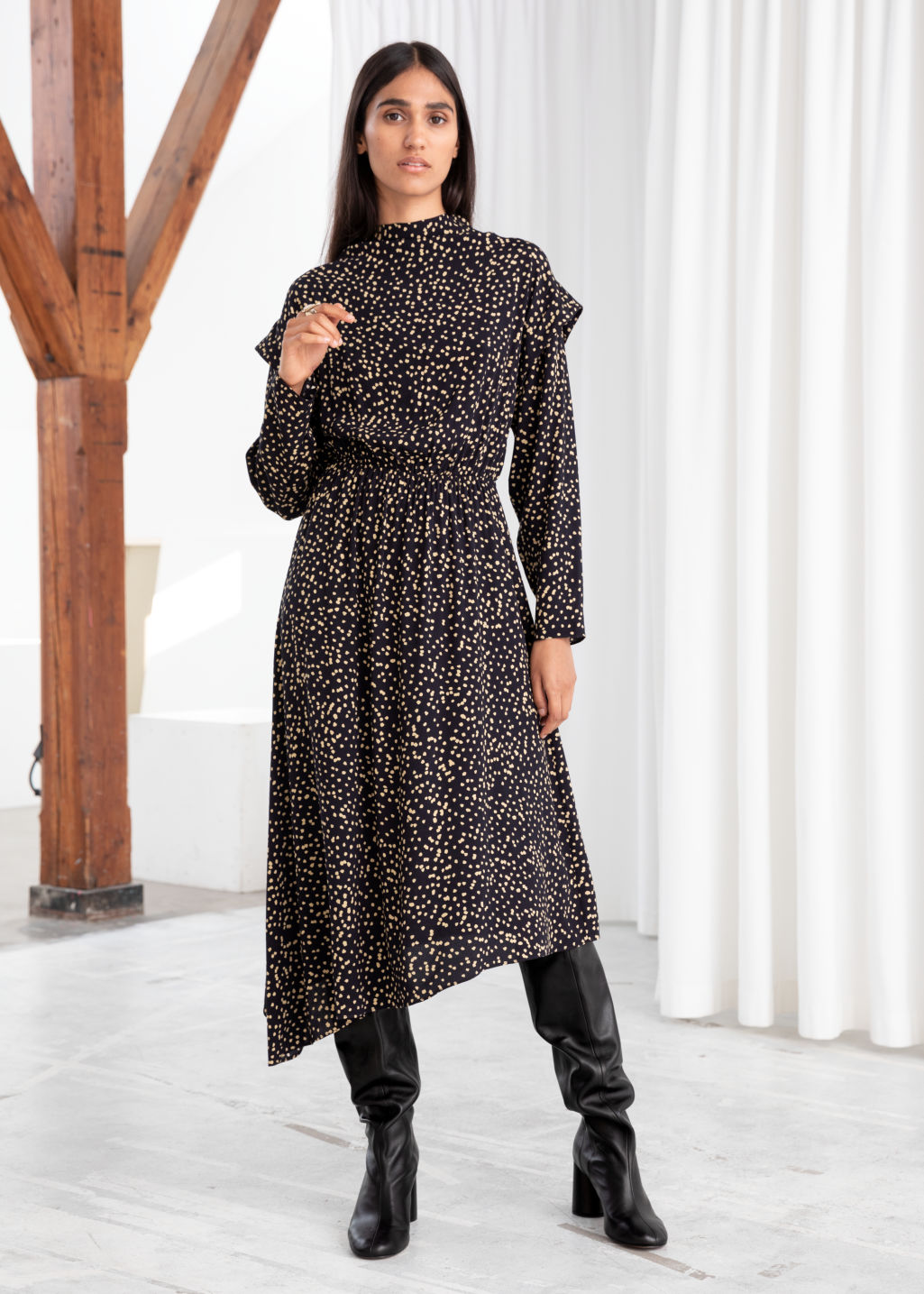 Model front image of Stories dotted asymmetric midi dress in black