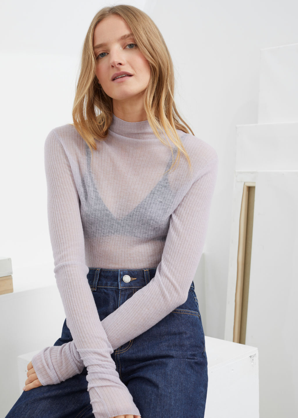 Model front image of Stories fitted cashmere turtleneck top in grey