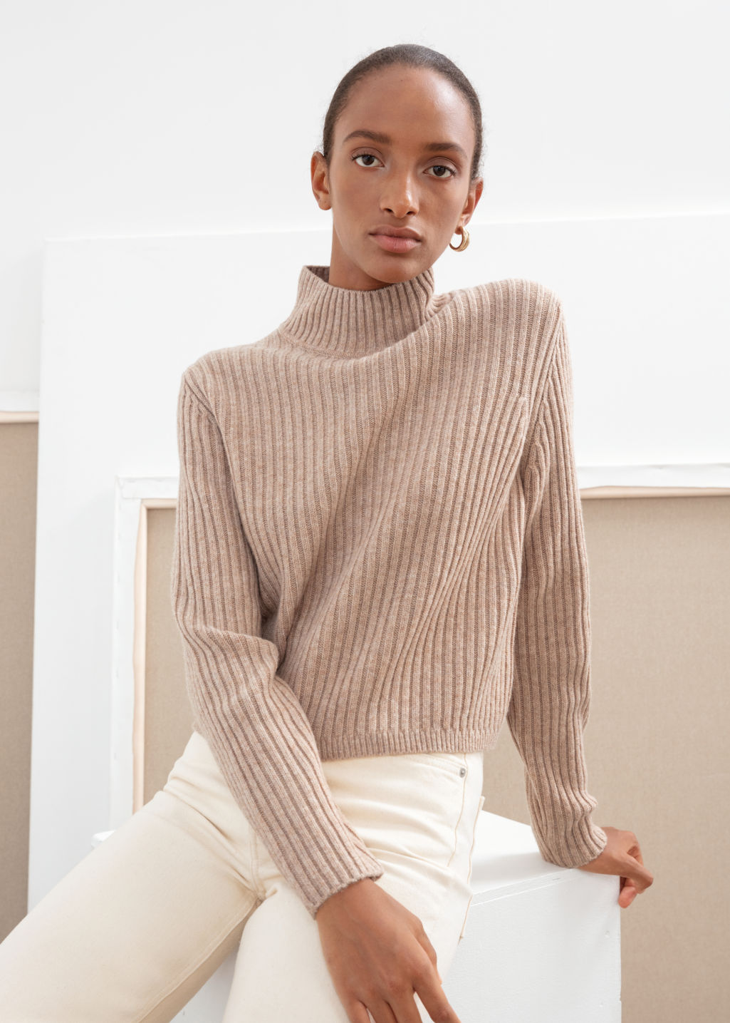 Model back image of Stories ribbed wool relaxed turtleneck in beige