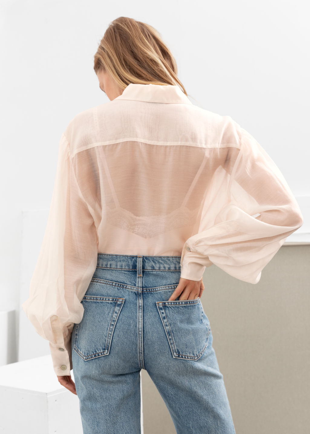 Model back image of Stories flowy puff sleeve button up shirt in beige