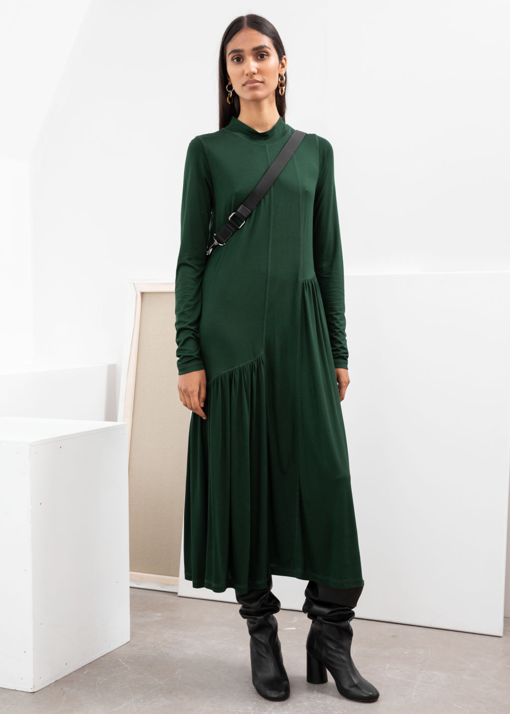 Model front image of Stories asymmetric turtleneck midi dress in green