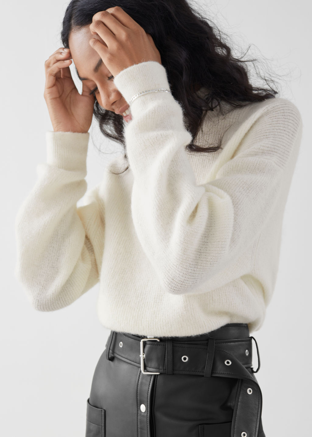 Model front image of Stories wool blend oversized mock neck sweater in white