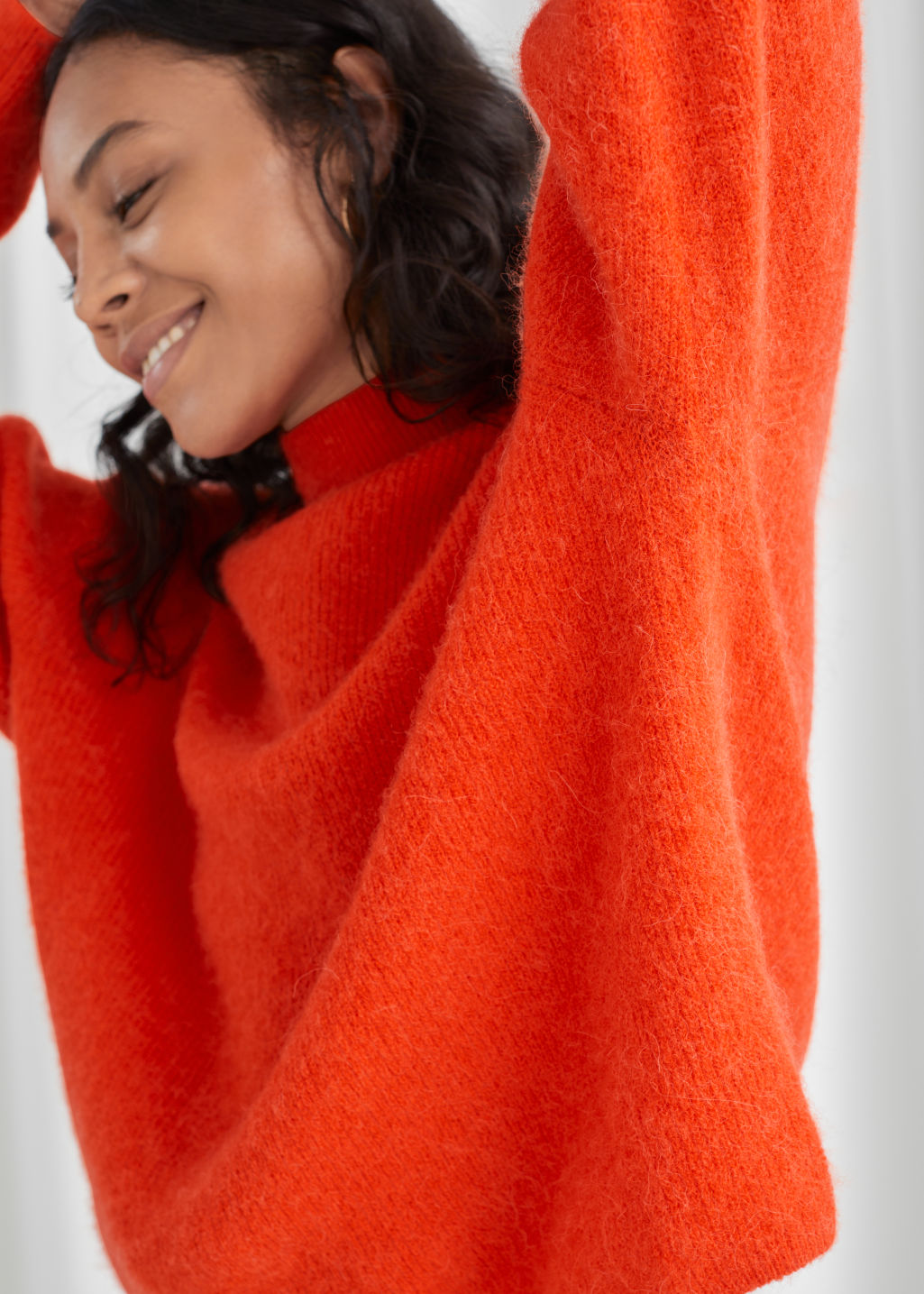 Model front image of Stories wool blend oversized mock neck sweater in orange