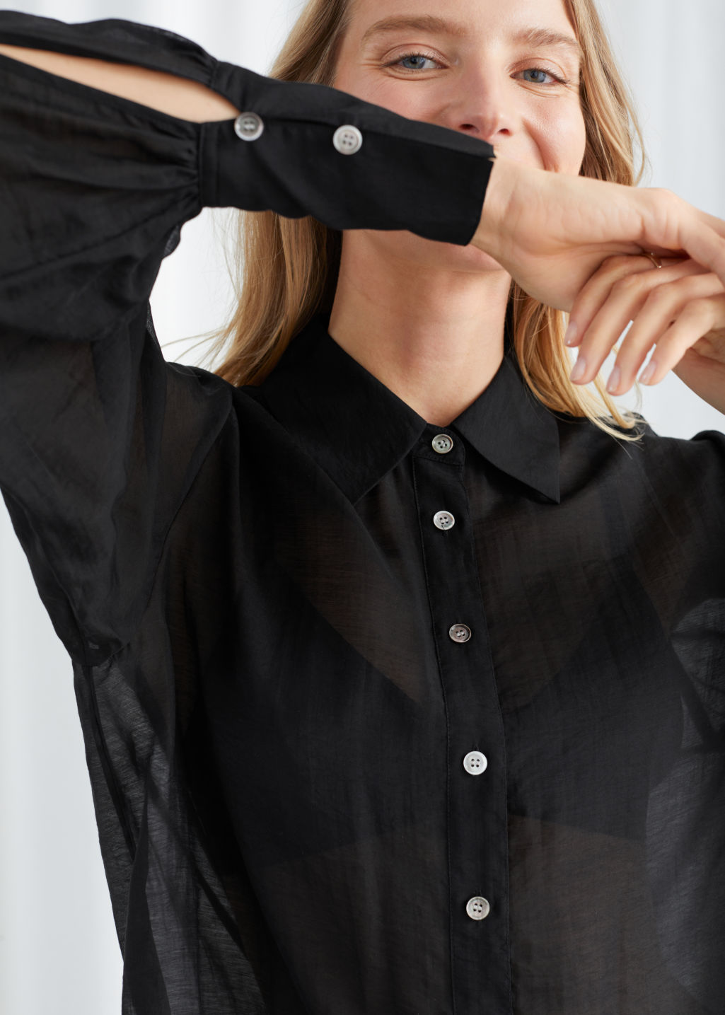 Model front image of Stories semi-sheer lyocell blend blouse in black