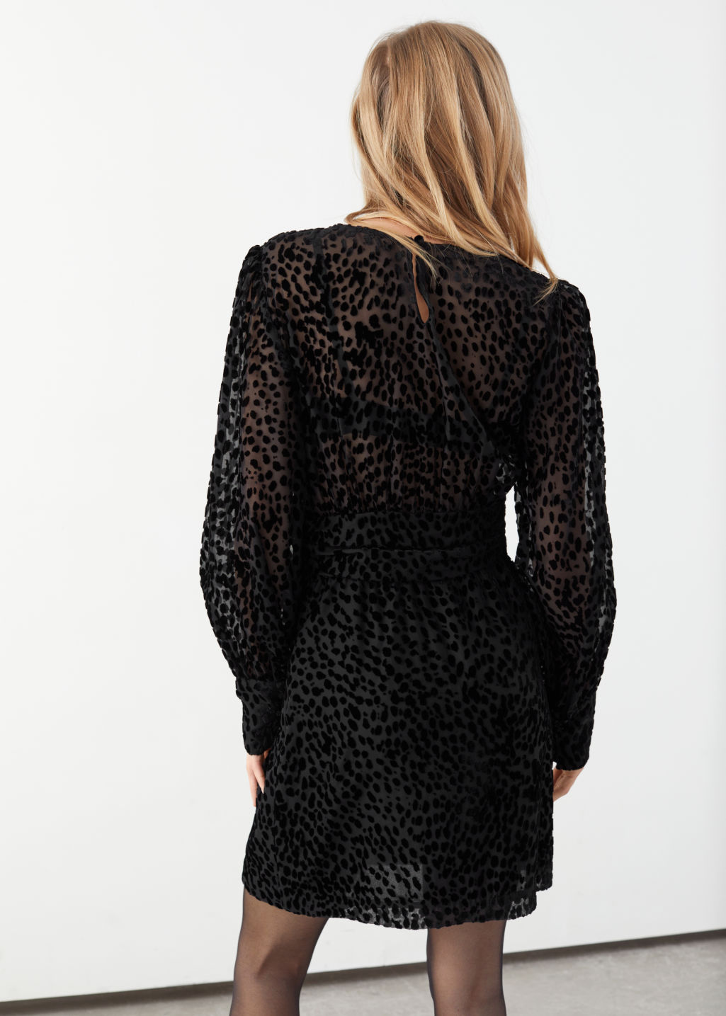 Model back image of Stories sheer leopard jacquard mini dress in black