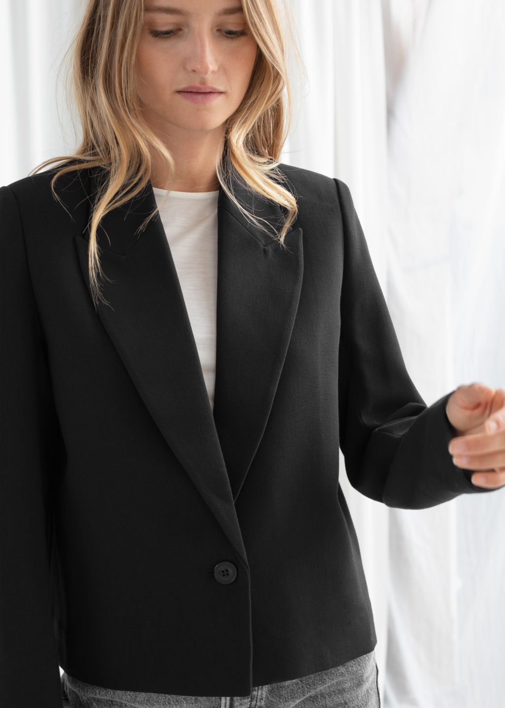 Model front image of Stories pointed lapel single button blazer in black
