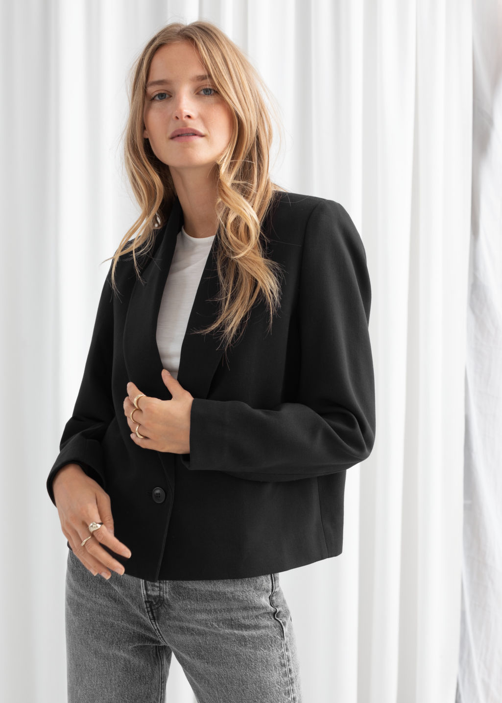 Model back image of Stories pointed lapel single button blazer in black