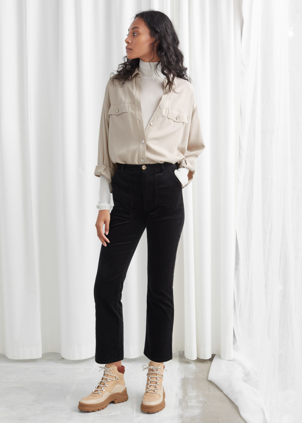 Model front image of Stories slim corduroy kick flare trousers in black