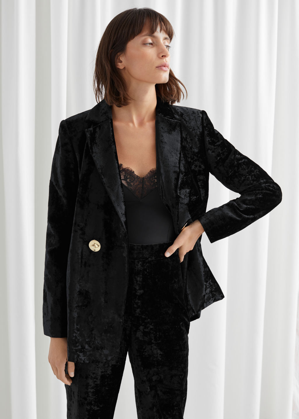Model front image of Stories velvet gold button blazer in black