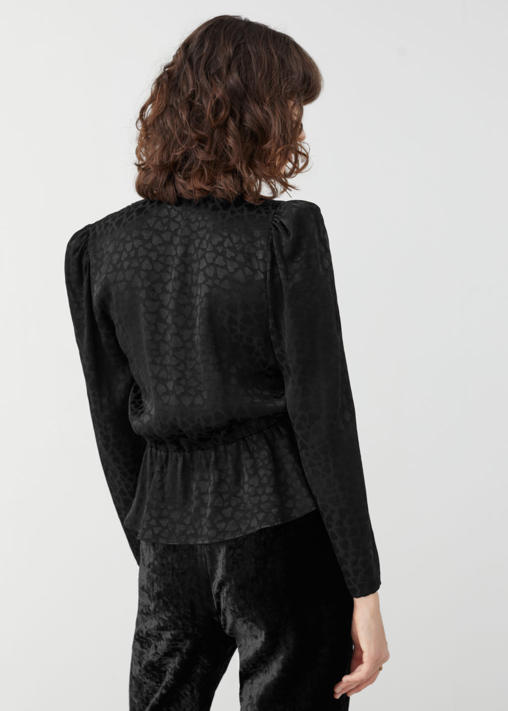 Model back image of Stories jacquard ruffled wrap blouse in black
