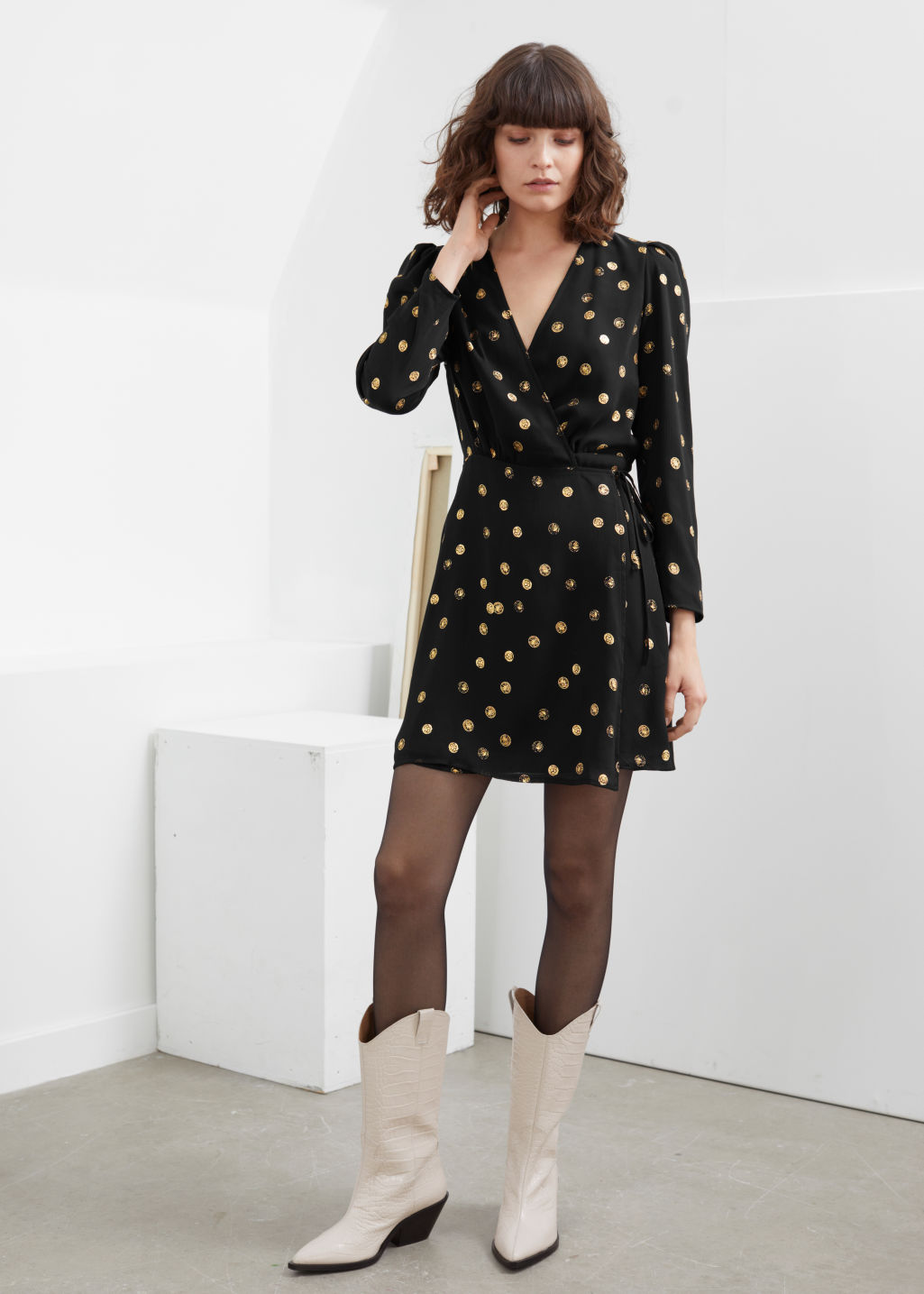 Model front image of Stories metallic coin print mini wrap dress in black