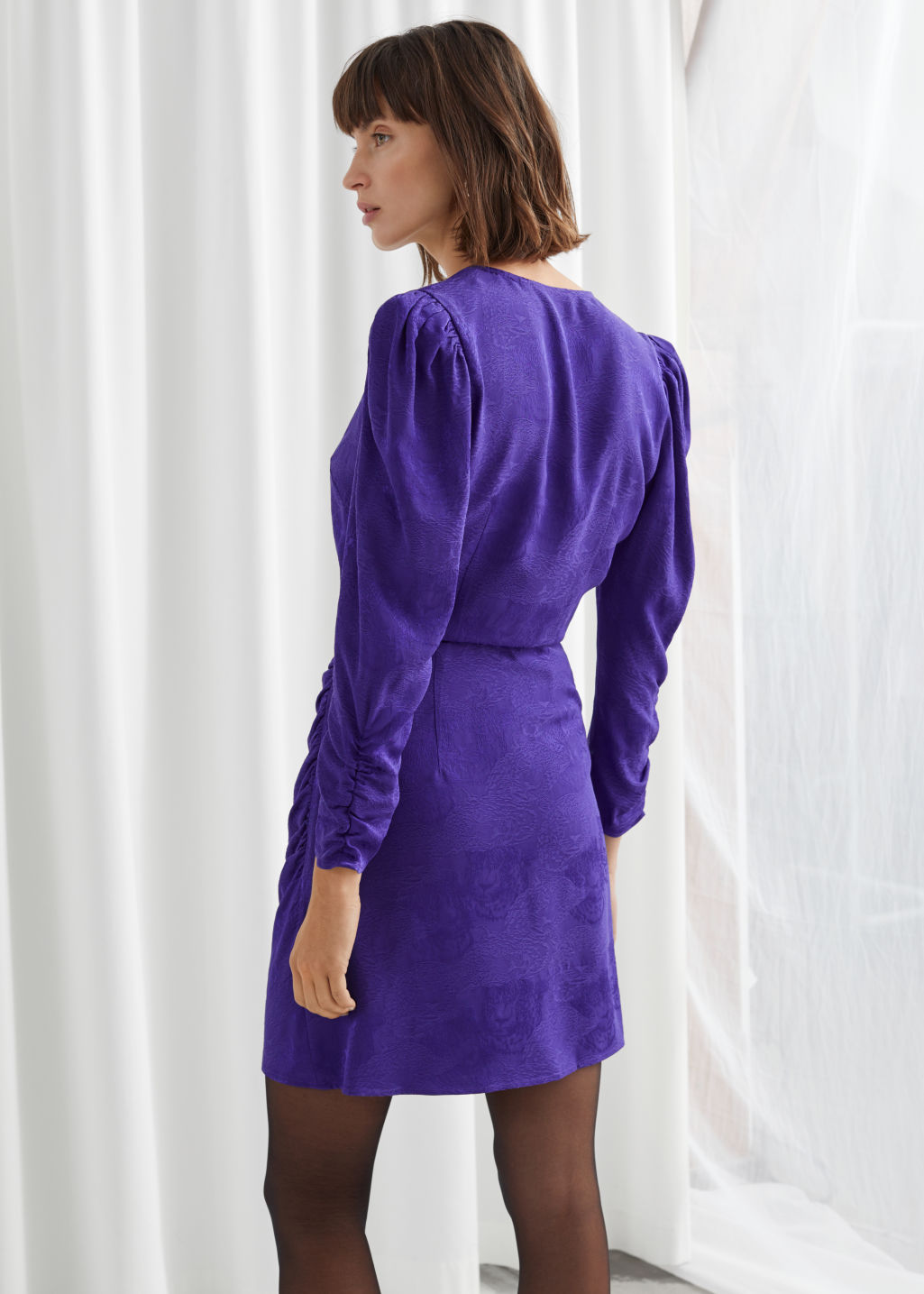 Model back image of Stories  in purple