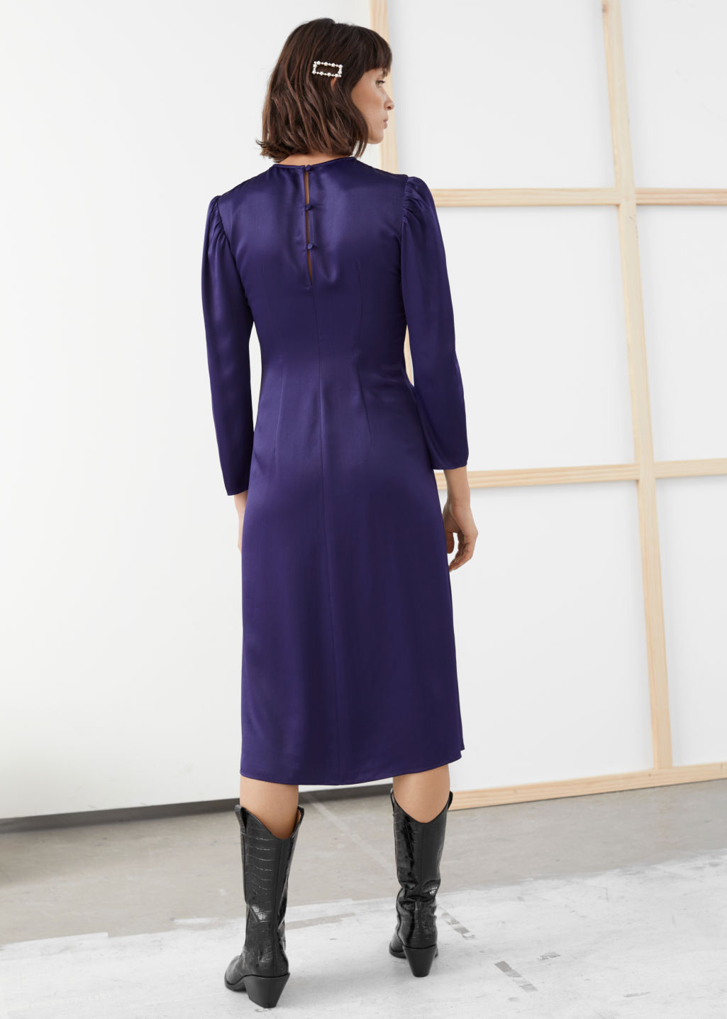 Model back image of Stories ruched satin midi dress in purple