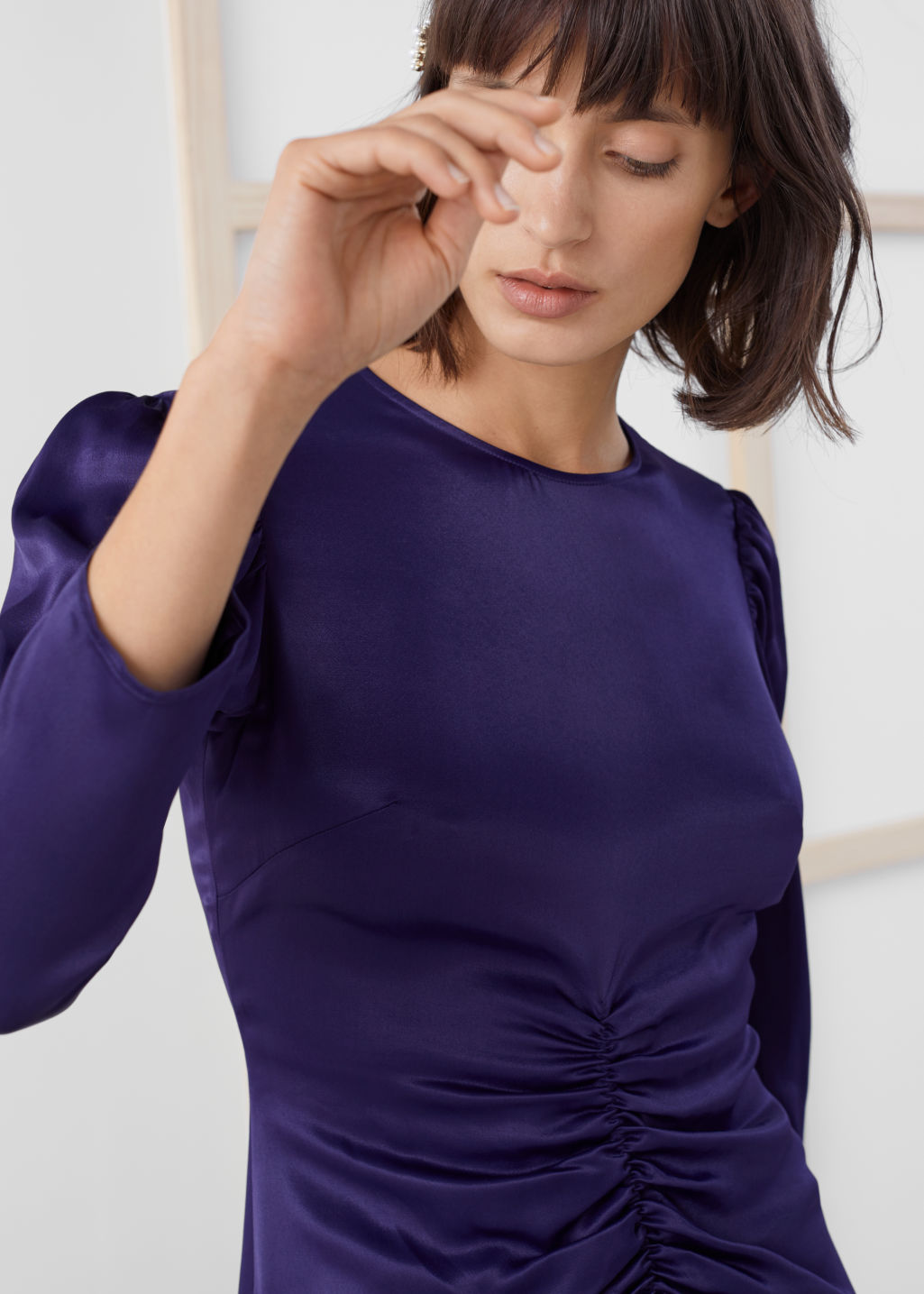 Model front image of Stories ruched satin midi dress in purple