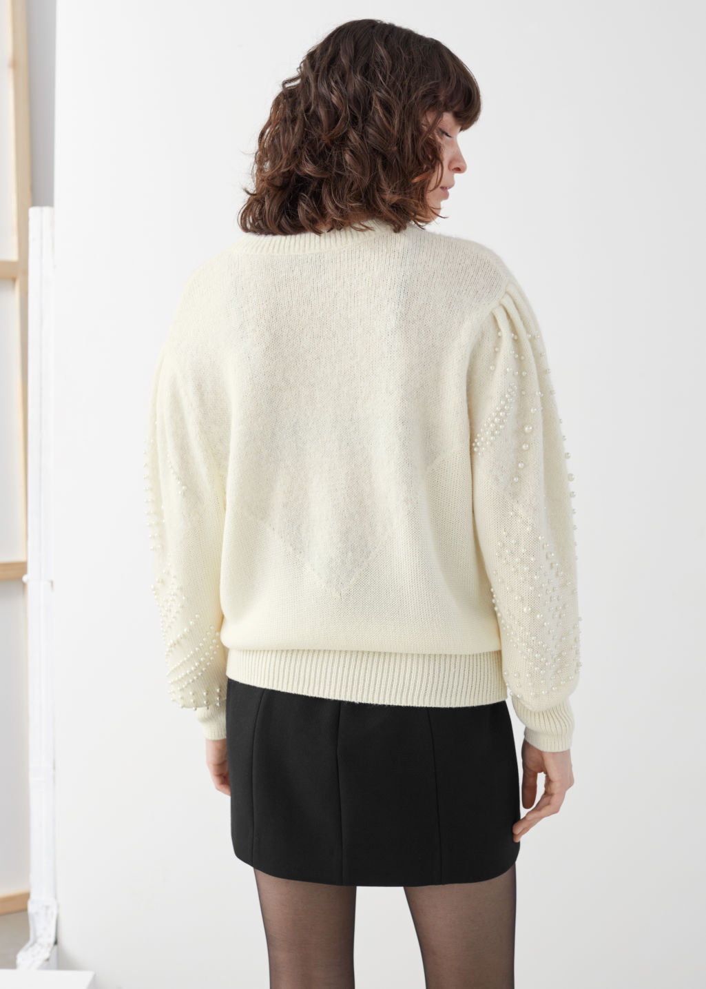 Model back image of Stories pearl embellished knitted sweater in white