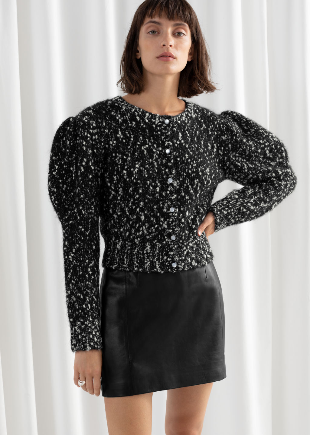 Model front image of Stories puff sleeve bouclé cropped cardigan in black