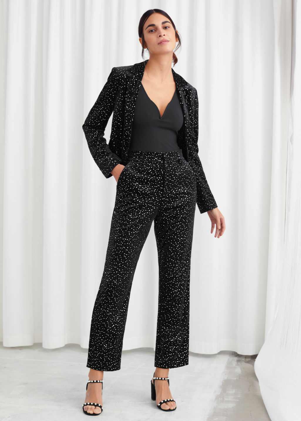 Model front image of Stories tailored velvet sequined trousers in black