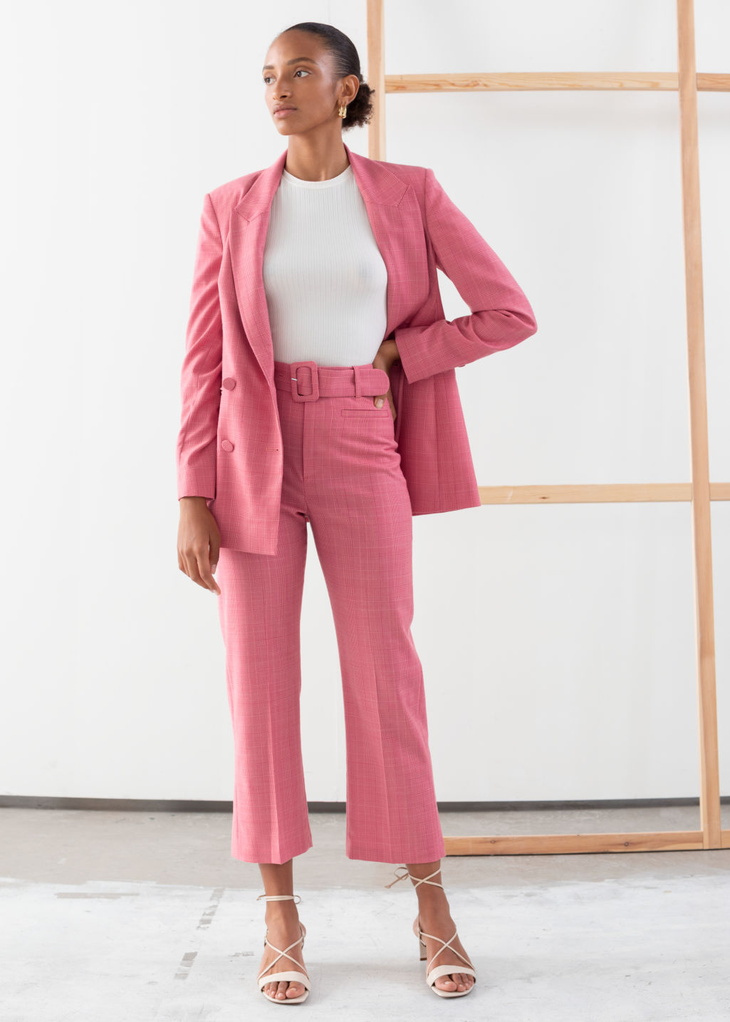 Model front image of Stories belted plaid kick flare trousers in pink