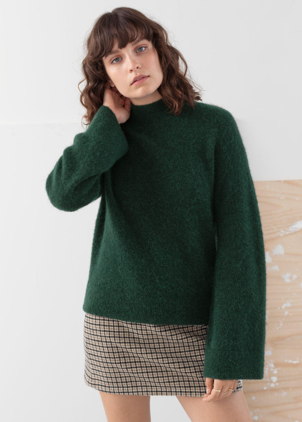 Model front image of Stories alpaca blend turtleneck sweater in green