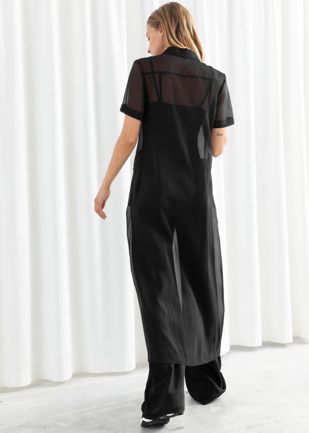 Model back image of Stories sheer patch pocket maxi dress in black