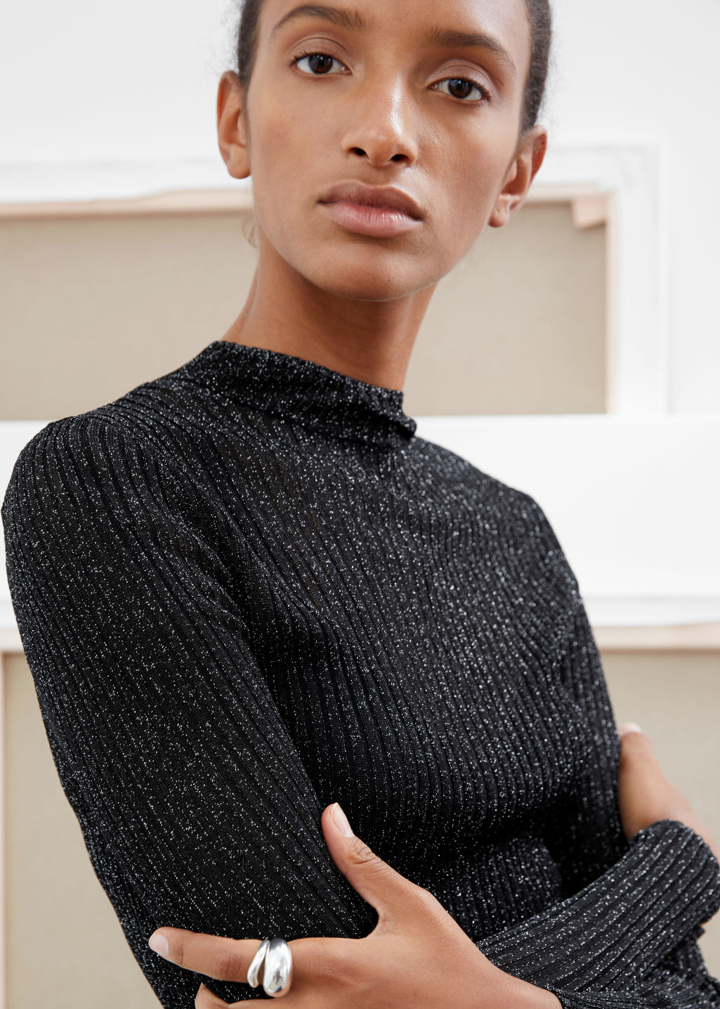 Model front image of Stories glitter ribbed mock neck sweater in black