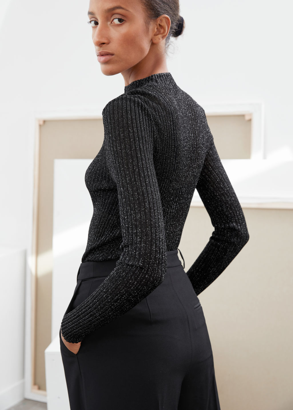 Model back image of Stories glitter ribbed mock neck sweater in black