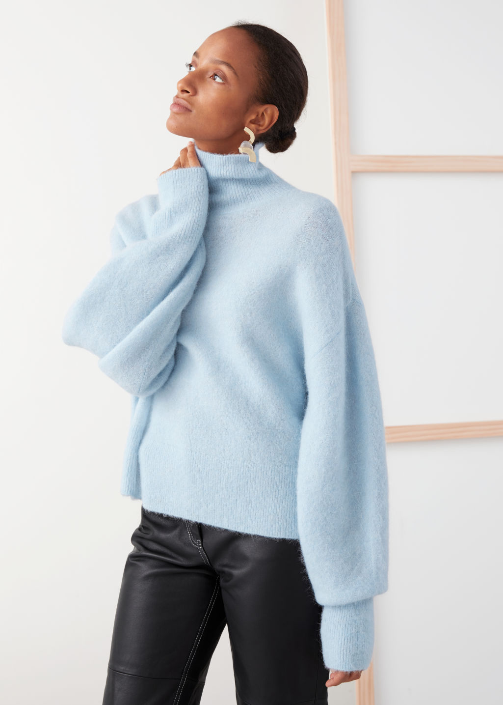 Model front image of Stories soft wool blend turtleneck sweater in blue