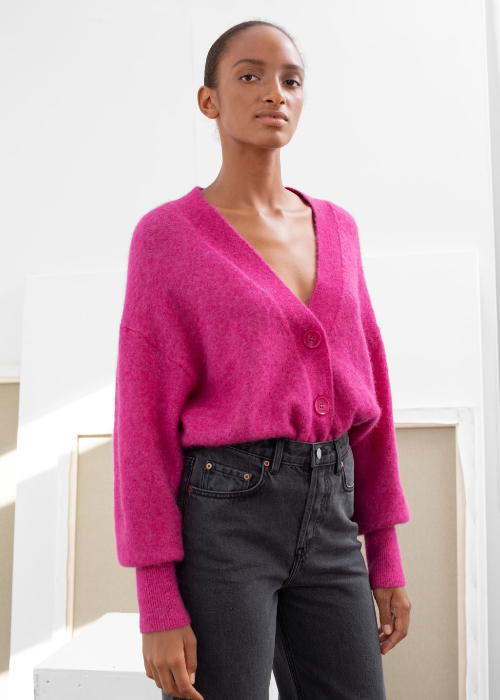 Model front image of Stories alpaca blend puff sleeve cardigan in pink