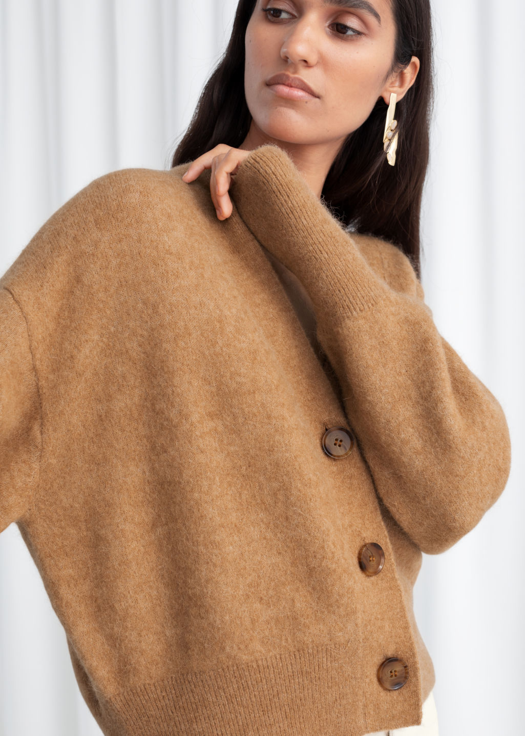 Model front image of Stories alpaca blend puff sleeve cardigan in beige