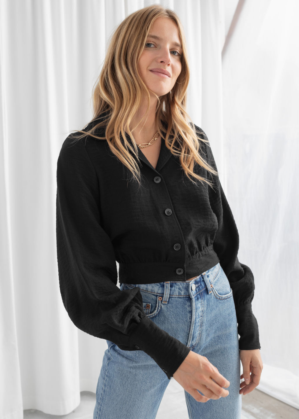 Model front image of Stories dobby puff sleeve button up blouse in black