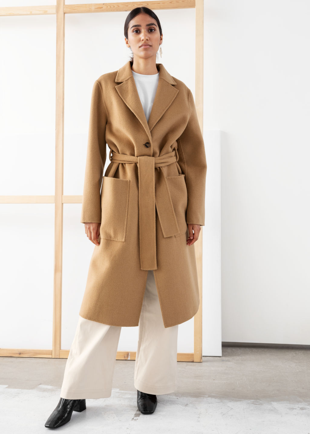 Model front image of Stories wool blend belted long coat in beige