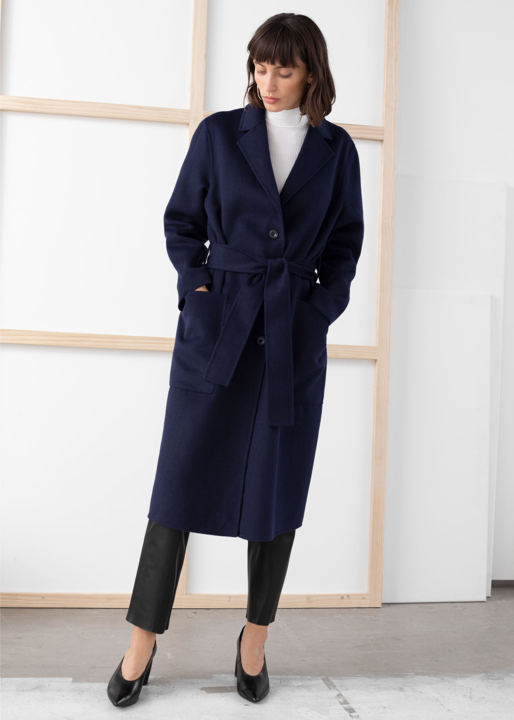 Model front image of Stories wool blend belted long coat in blue