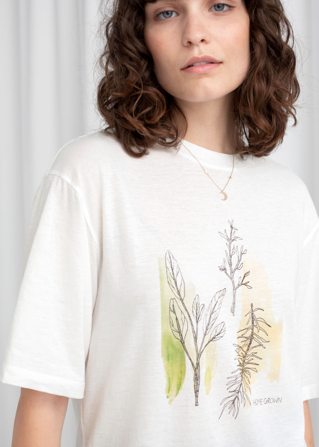 Model front image of Stories oversized oh man graphic tee in white