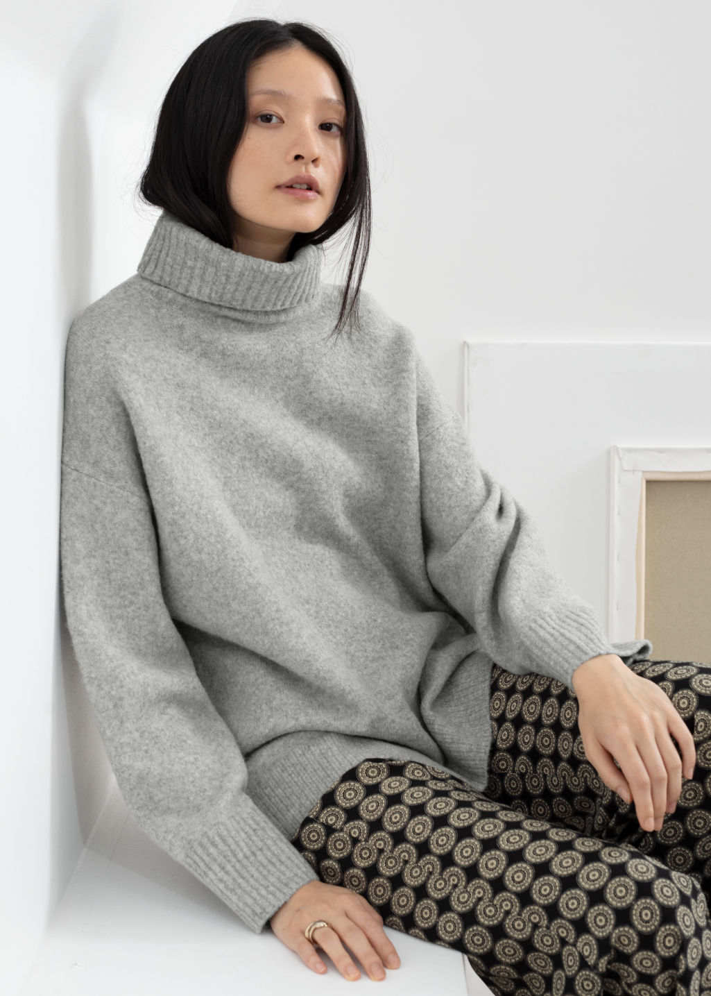 Model front image of Stories slouchy oversized turtleneck sweater in grey