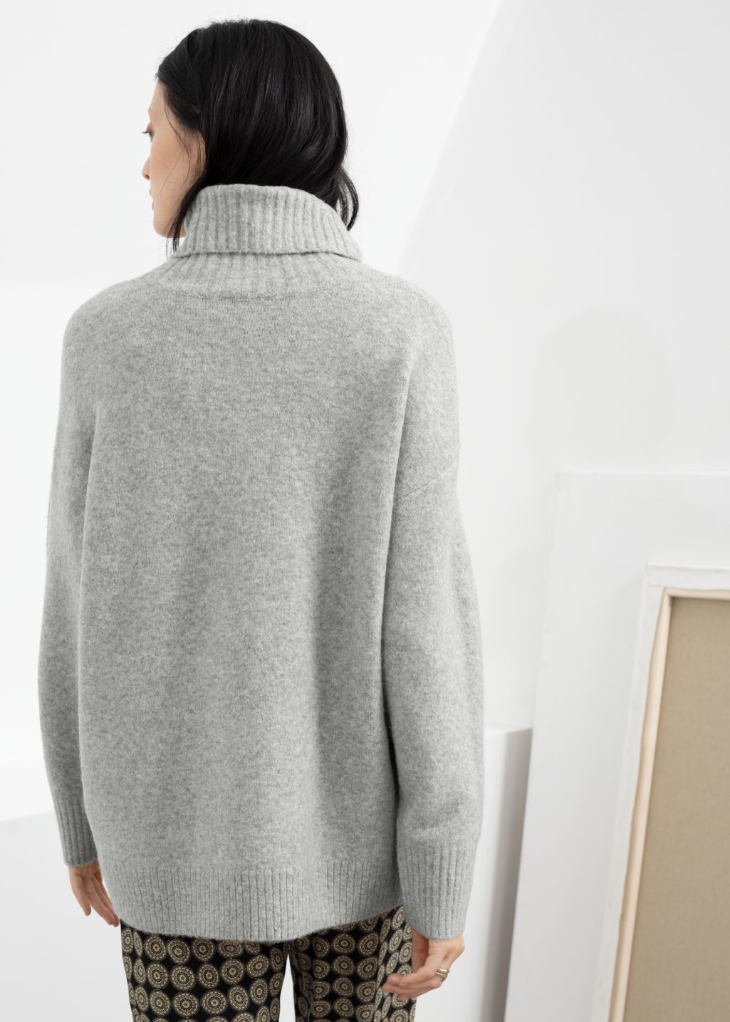 Model back image of Stories slouchy oversized turtleneck sweater in grey