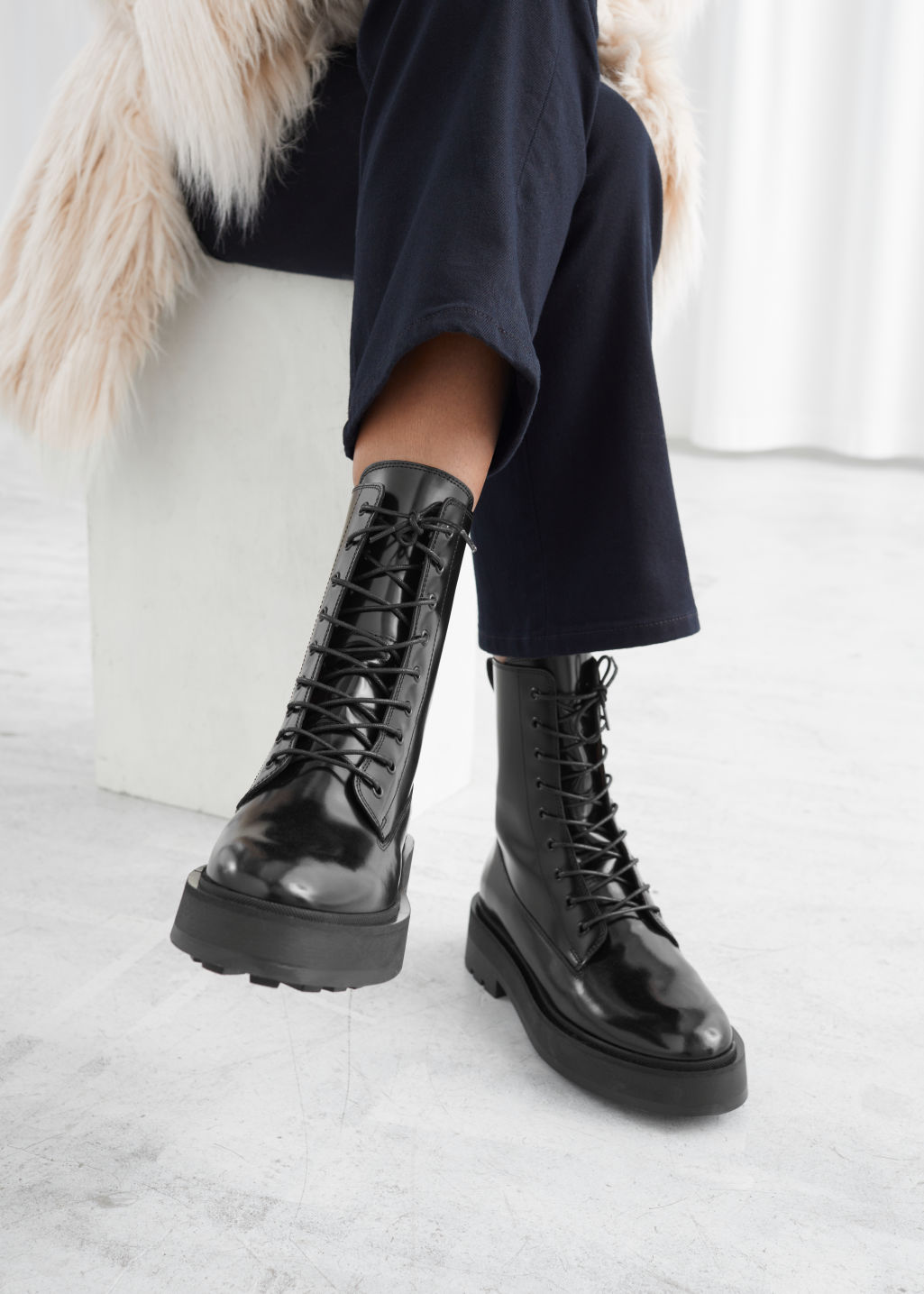 Model front image of Stories chunky leather lace-up boots in black