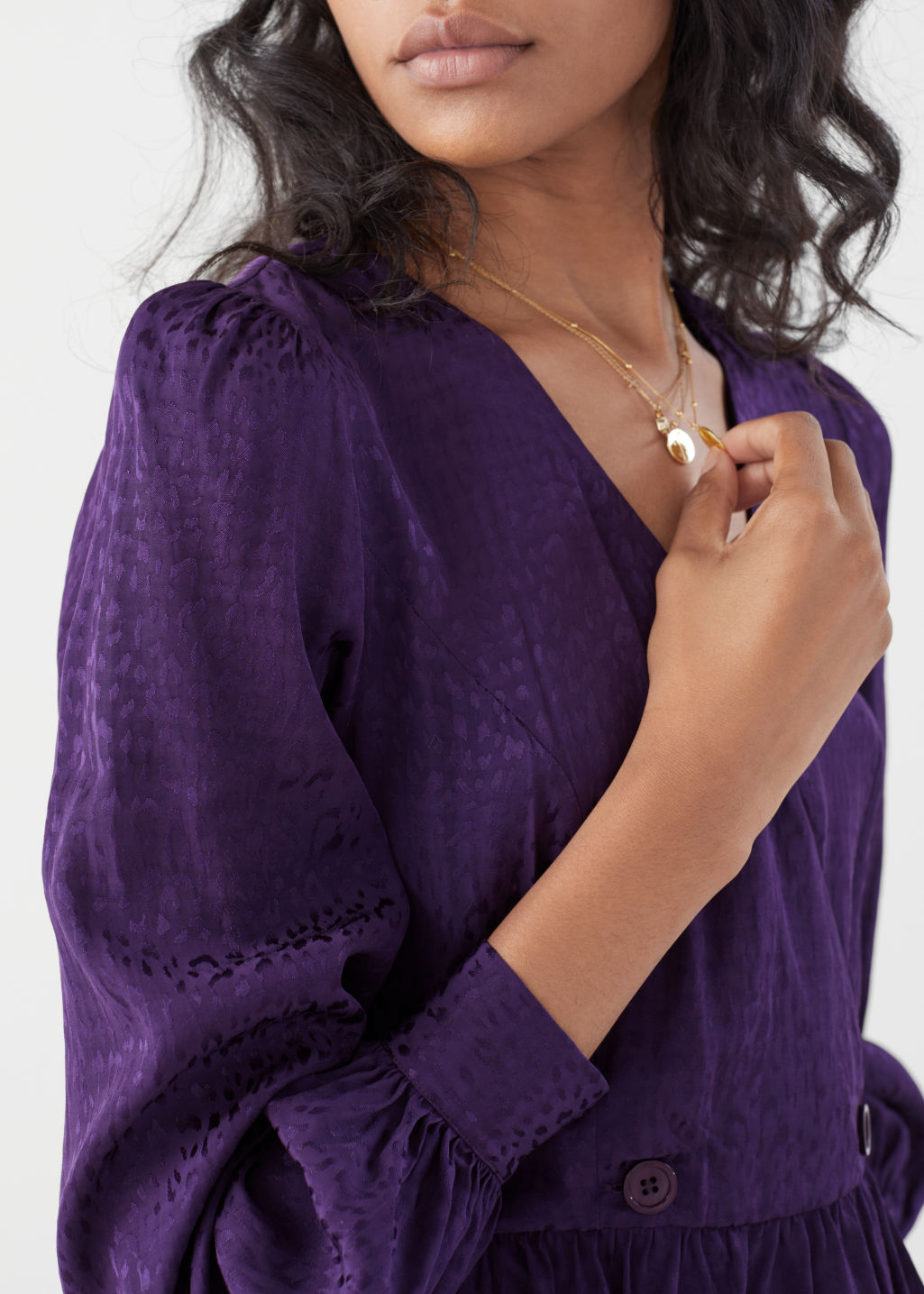 Model front image of Stories leo jacquard duo button wrap blouse in purple