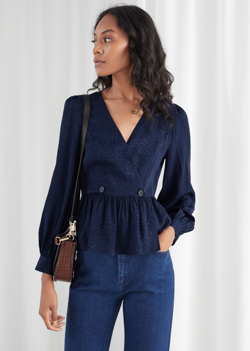 Model front image of Stories leo jacquard duo button wrap blouse in blue