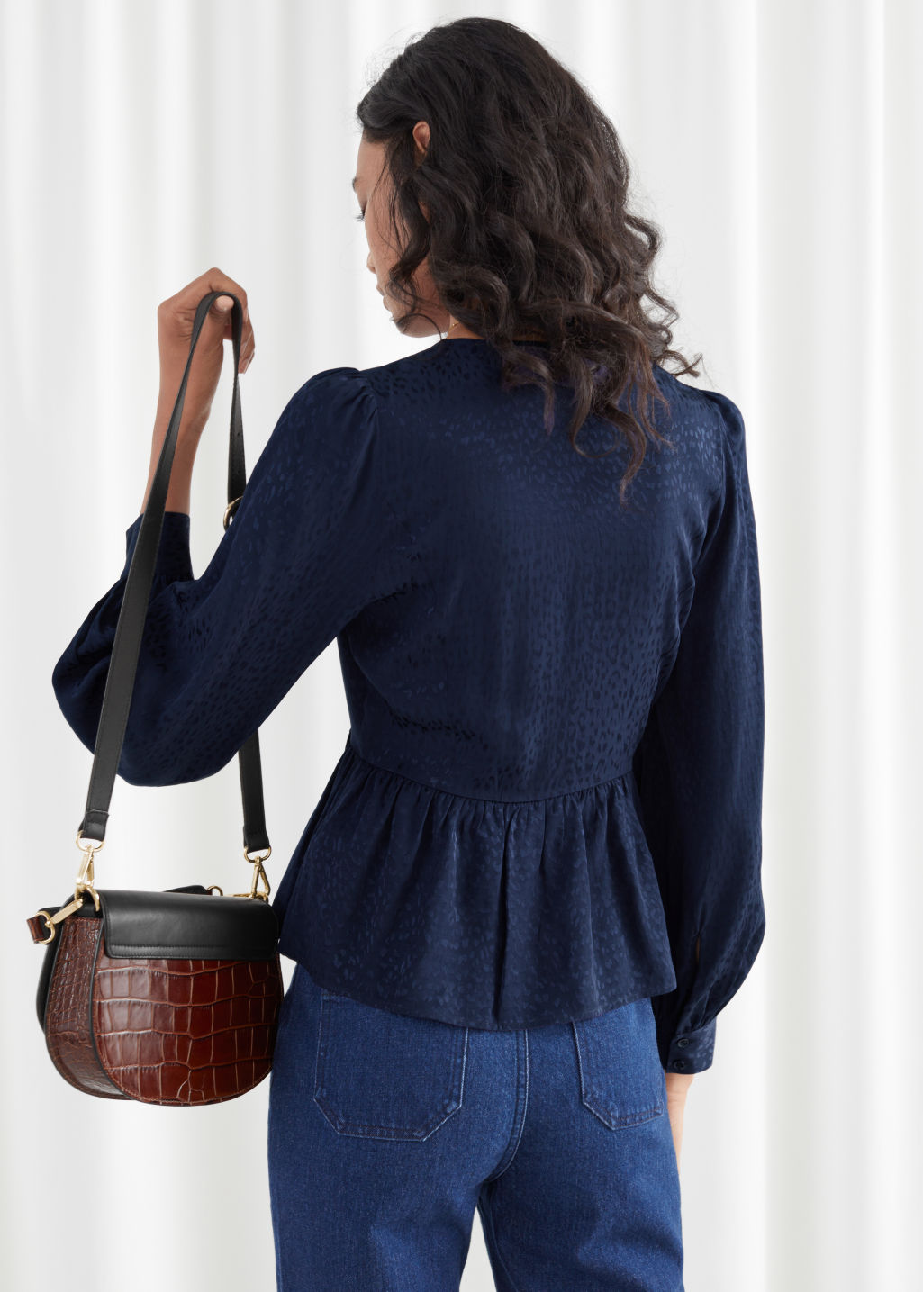 Model back image of Stories leo jacquard duo button wrap blouse in blue