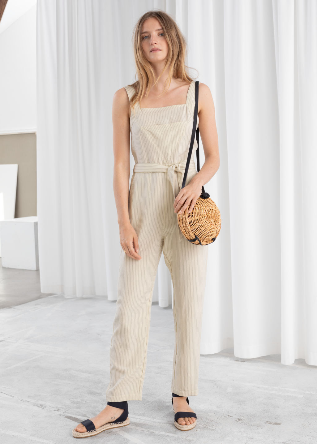 Model front image of Stories lyocell linen blend jumpsuit in beige