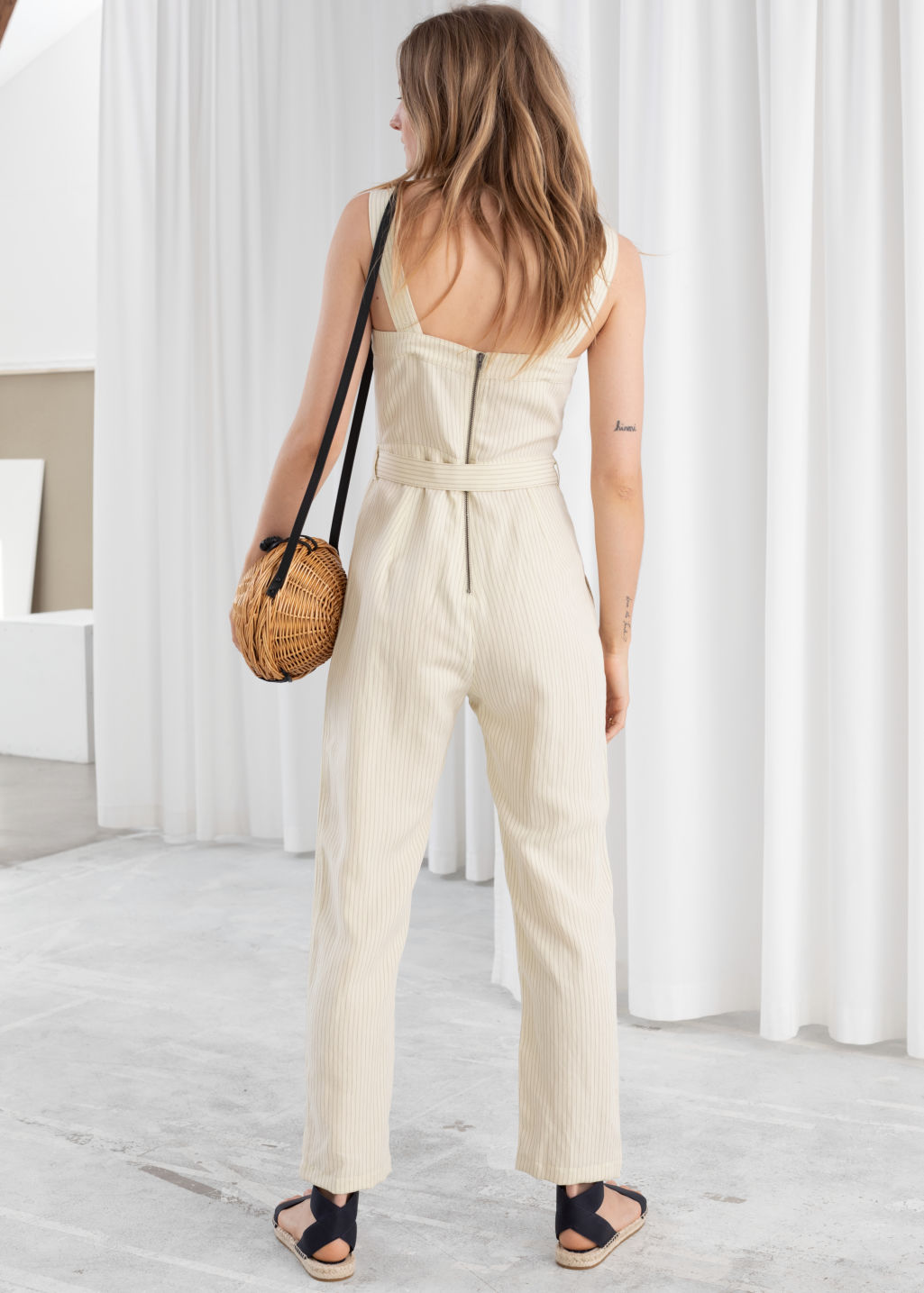 Model back image of Stories lyocell linen blend jumpsuit in beige