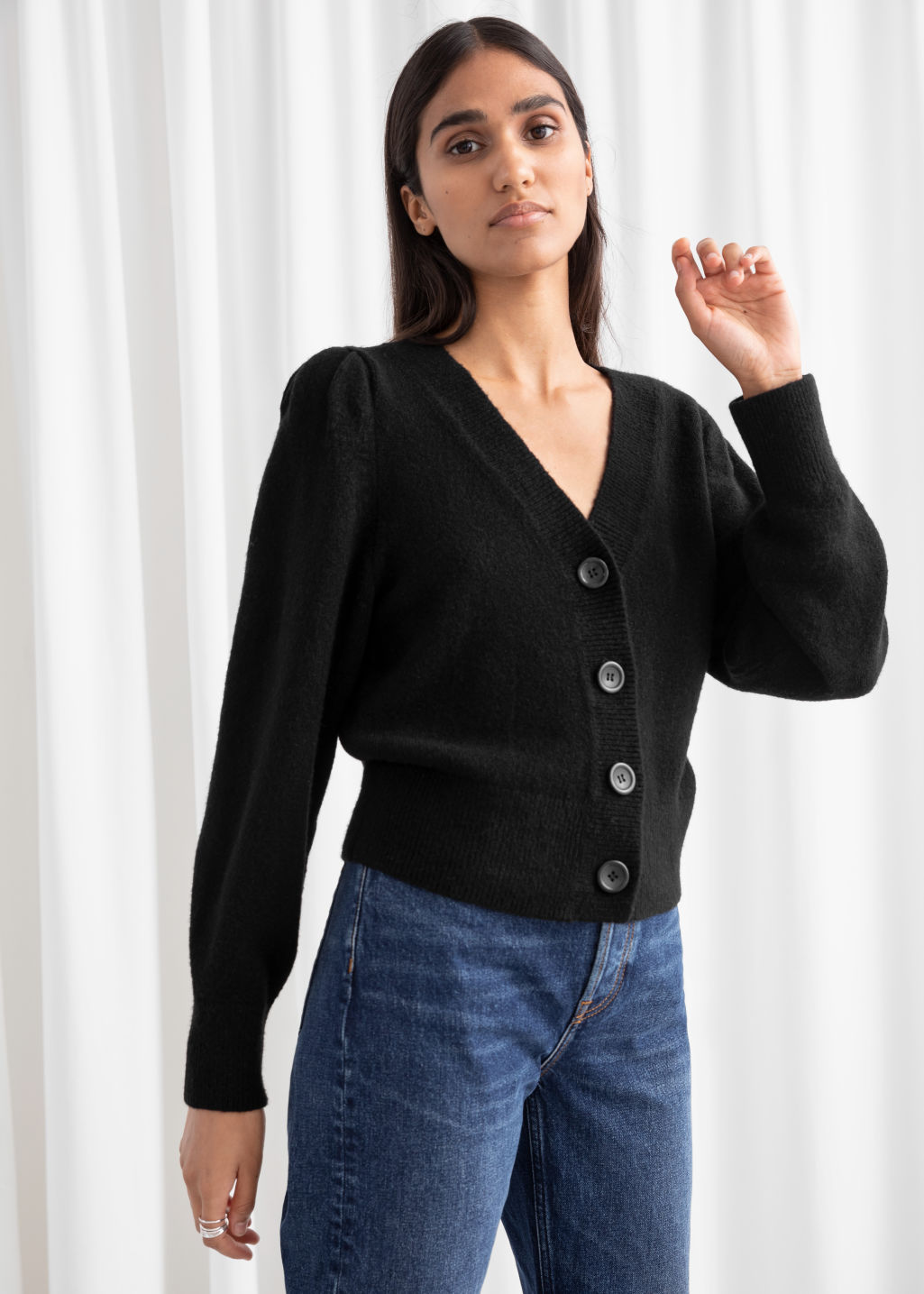 Model front image of Stories puff sleeve cropped cardigan in black