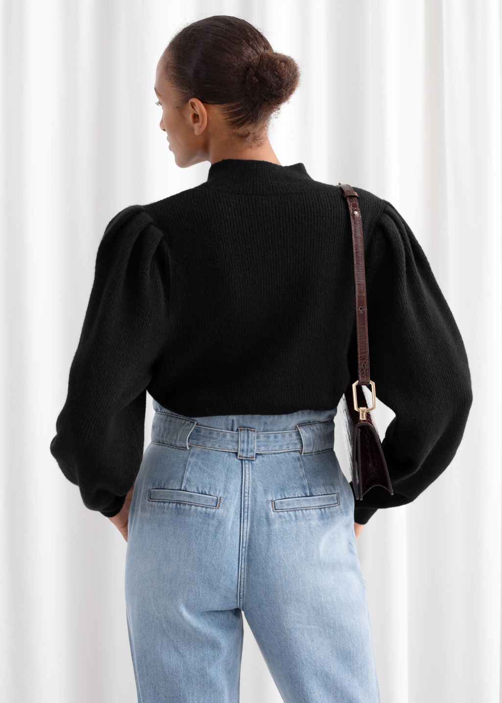 Model back image of Stories mock neck puff sleeve sweater in black